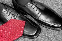 black leather dress shoes and necktie - stock photo