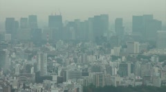 Tokyo skyline covered in smog Stock Footage