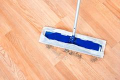 Cleaning wooden floor Stock Photos