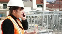 Construction Worker in Heated Discussion on Cell Phone Stock Footage