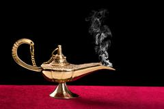 Burning magic lamp Stock Photos