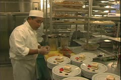 Stock Video Footage of Queen Mary 2 ocean liner, galley, kitchen, chefs plating deserts