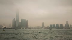 Time Lapse of Sea Traffic on a foggy morning by ICC building - stock footage
