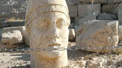Ancient marble head and chain Stock Footage