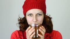 Beautiful girl drinking tea Stock Footage