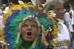 Carnival in Rio, Carnaval, daytime, old woman in Indian headdress Stock Footage