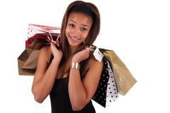 Stock Photo of young african american shopper isolated against a white background