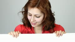 Girl showing  white table for writing Stock Footage