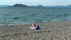 Single woman getting a tan Stock Footage