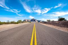 Remote desert road Stock Photos