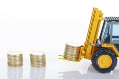 euro money coins and forklift - stock photo