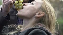 Man feeding his girlfriend with grapes, super slow motion, shot at 240fps HD Stock Footage