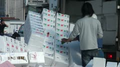 Unloading foam boxes at Tsukiji fish market, Tokyo, Japan Stock Footage
