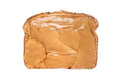 slice of bread with peanut butter - stock photo