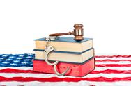 Gavel, books and handcuffs on american flag Stock Photos