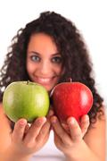 Stock Photo of young woman holding apple. isolated over white