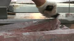 Cutting frozen tuna at the Tsukiji fish market in Tokyo Stock Footage