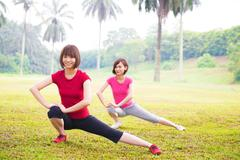 Stock Photo of two asian girls stretching