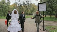 The marrying couple with the photographer. wedding Stock Footage