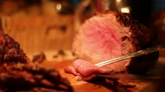 butcher chef cutting cooked roast cu - stock footage