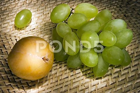 Stock photo of still-life with grapes and plum