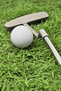 golf ball and putter - stock photo