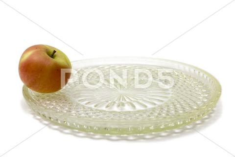 Stock photo of one apple on the big dish