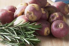 Apache potatoes and rosemary Stock Photos