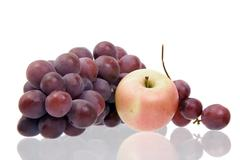 Still-life with grapes and an apple Stock Photos