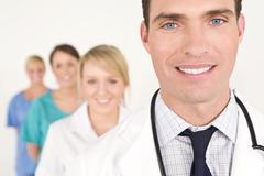 Male doctor and female nurses medical team Stock Photos