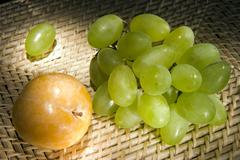 yellow plum and grapes - stock photo
