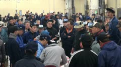 Traders take part in tuna auction at Tsukiji fish market in Tokyo Japan Stock Footage