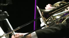 Playing on a trombone in a orchestra - stock footage