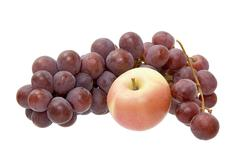 Apple and grapes on a white background Stock Photos