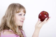 portrait of the girl with apple - stock photo
