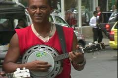 Carnival in Rio, Carnaval, daytime, Cinelandia Square, banjo player, close Stock Footage