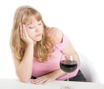 Stock Photo of alcoholic dream of the young woman