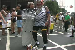Carnival in Rio, Carnaval, daytime, couple with crazy dog Stock Footage