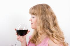 The young woman with a wine glass Stock Photos