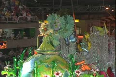 Carnival in Rio, Carnaval, nighttime, Samba Parades, girl on giant float Stock Footage