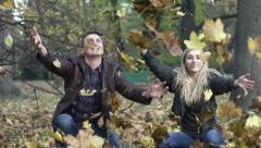 Couple throwing golden leaves in autumn park, slow motion, shot at 240fps HD Stock Footage