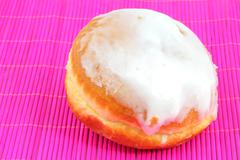 Donut with frosting Stock Photos