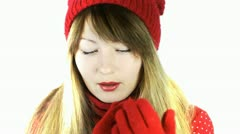 Frozen beautiful girl in a red hat and gloves, rubbing his hands Stock Footage