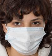 Stock Photo of girl in a medical mask