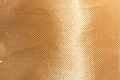 golden fabric as a background. macro - stock photo