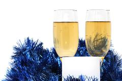 champagne glasses with a plastic card for the new year - stock photo