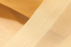 Golden fabric as a background. macro Stock Photos