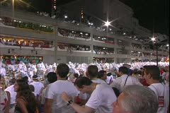 Carnival in Rio, Carnaval, Samba Parades, wide shot, crowd watches parade Stock Footage