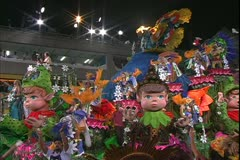 Carnival in Rio, Carnaval, Samba Parades, elaborate float, cartoon characters Stock Footage
