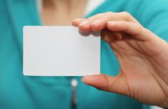 Stock Photo of white card in hand